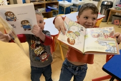 Choosing free books to take home brings smiles!