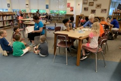Volunteers reading to students in 21st Century Community Learning Centers summer program at Snyder Girotti in Bristol Borough