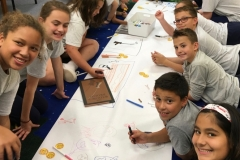 Children at St. Mark Bristol Borough drawing their responses to The Widow's Broom