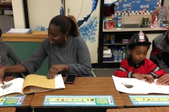 A family enjoys reading together at Family Literacy Night in Morrisville.